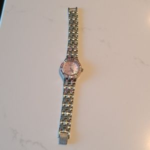 Womens Armitron silver watch with pink crystals